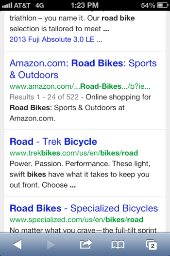 Google's new mobile interface displays organic content below paid ads.
