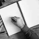 The men writes in an open notebook with blank pages on wooden desk closeup. Top view. Copy space. Free space for text; Shutterstock ID 313426874; team: creative